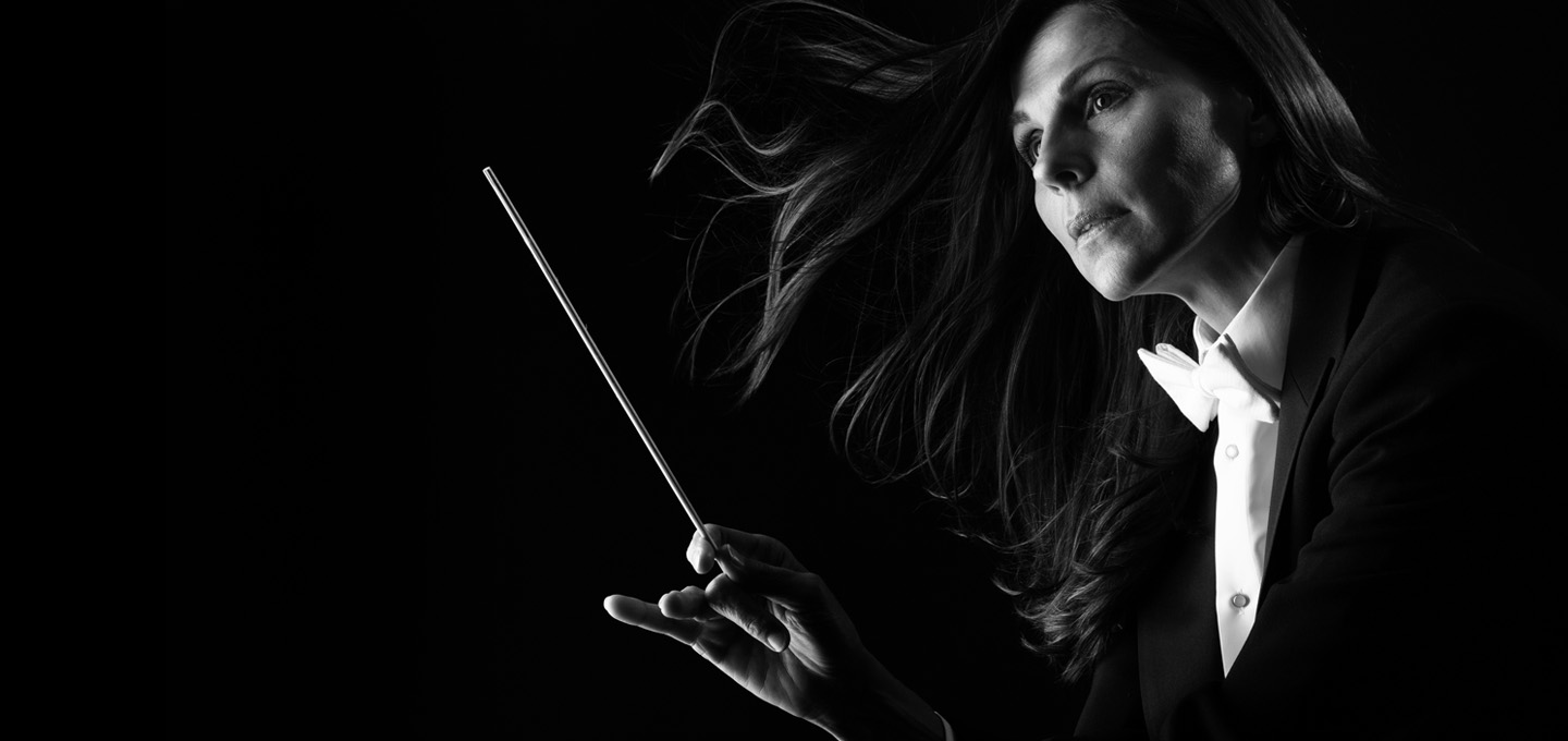 Woman conducting with a baton